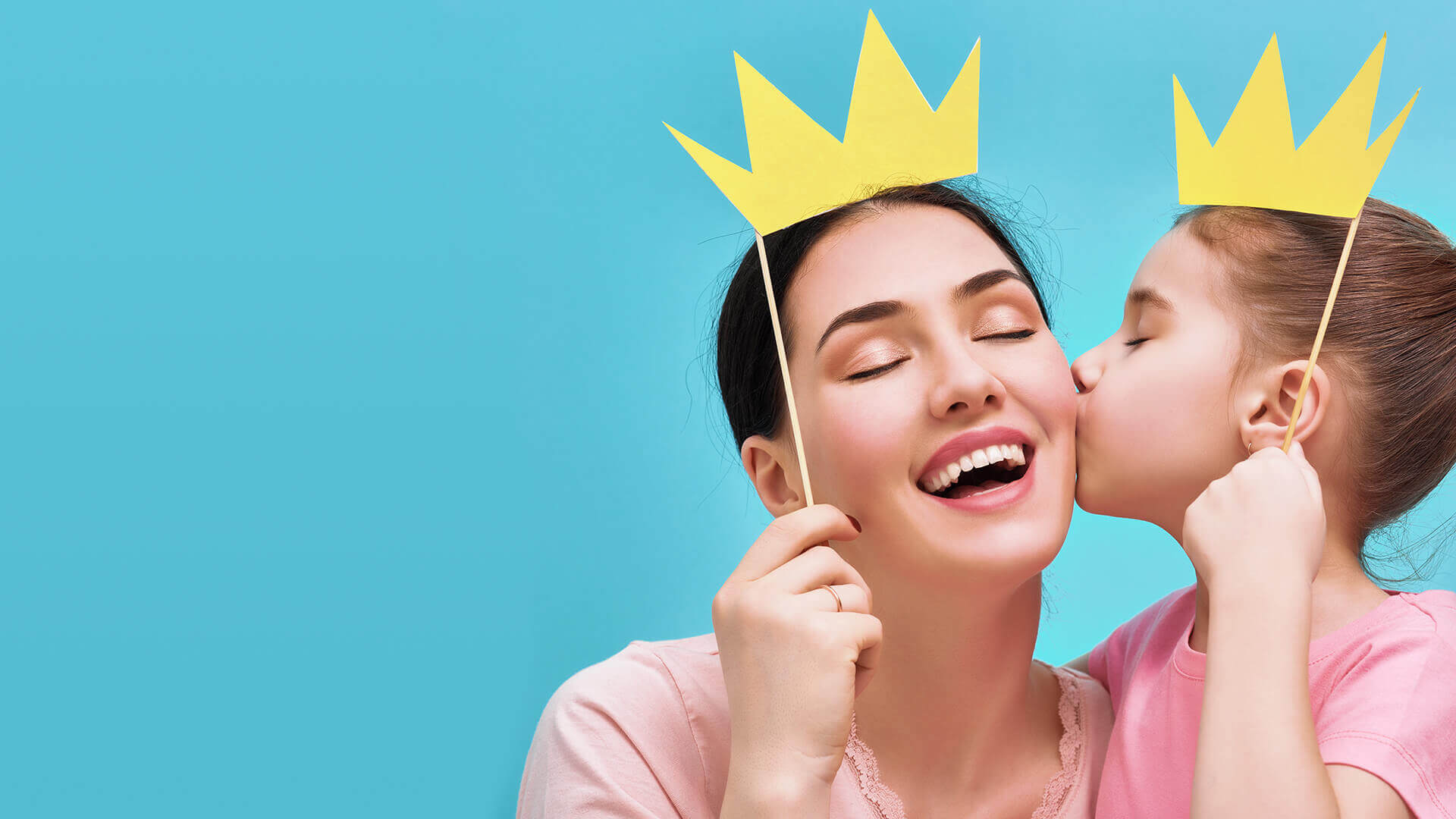 Image of mom and daughter holding paper crowns on their head. Tespo is good for the whole family.