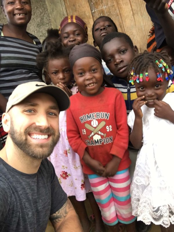 happy haitian children with author of article